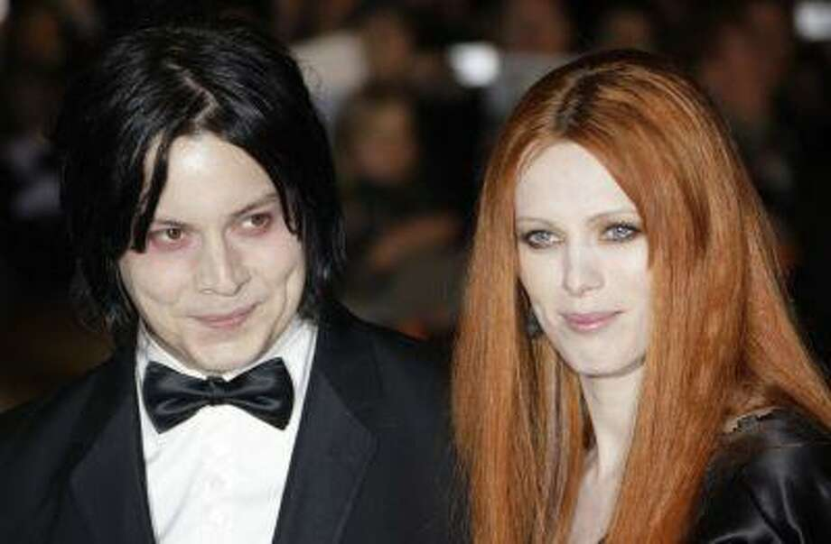 "FILE - In this Oct. 29, 2008 file photo, musician Jack White, left, and Karen Elson arrive on the red carpet for the Royal World Premiere of the 22nd James Bond film, ""Quantum of Solace"" in London. Elson filed a restraining order against White after she said in their divorce filings he was threatening her and she fears for her safety and her children's. Elson filed for a temporary restraining order July 17. It was approved by a judge pending a court hearing on Aug. 29. (AP Photo/Joel Ryan, file) Photo: ASSOCIATED PRESS / AP2008"