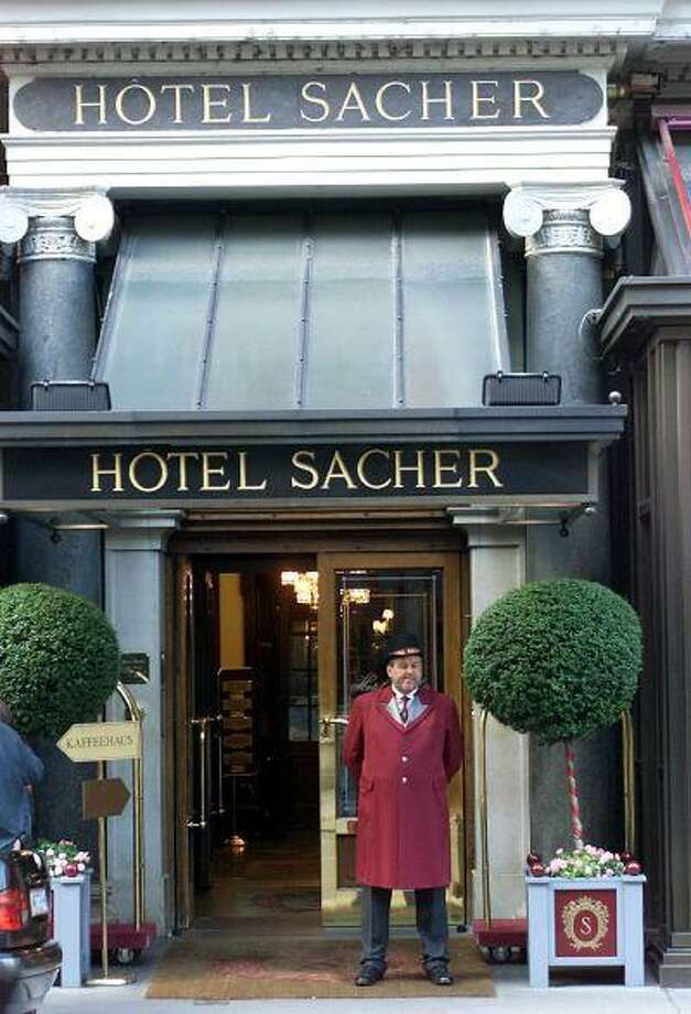 Hotel Sacher Employee stands in front of the hotel in downtown Vienna, Austria Friday, Sept. 7, 2001. Hotel Sacher opened in 1876 and will celebrate its 125 anniversary on Sunday, Sept. 9. (AP Photo/Rudi Blaha) Photo: Associated Press / AP