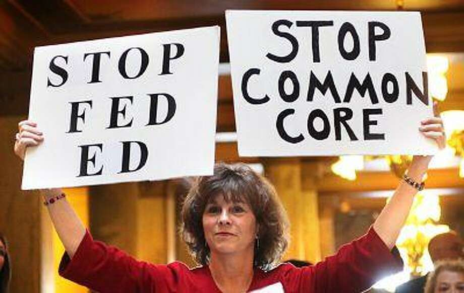 In this Jan. 16, 2013 file photo, concerned grandparent Sue Lile, of Carmel, Ind., shows her opposition to Common Core standards during a rally at the State House rotunda in Indianapolis. Photo: ASSOCIATED PRESS / AP2013