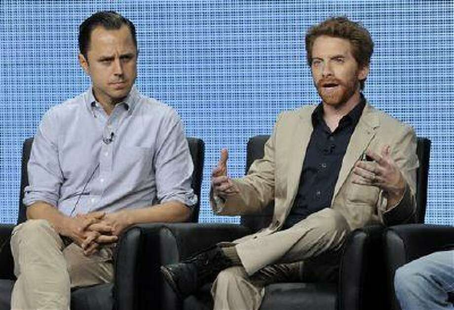 """Seth Green, right, a cast member on the FOX series """"dads,"""" answers a question as fellow cast member Giovanni Ribisi looks on during the FOX 2013 Summer TCA press tour at the Beverly Hilton Hotel on Thursday, Aug. 1, 2013 in Beverly Hills, Calif. (Photo by Chris Pizzello/Invision/AP) Photo: Chris Pizzello/Invision/AP / Invision"""