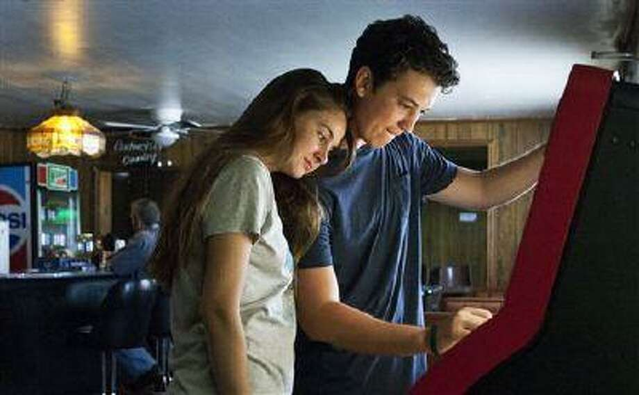 """This publicity image released by A24 Films shows Shailene Woodley, left, and Miles Teller in a scene from """"The Spectacular Now."""" (AP Photo/A24 Films) Photo: AP / A24"""