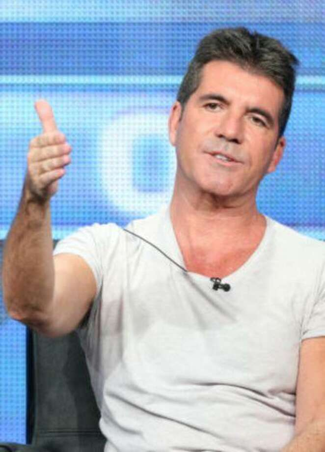 """No, Simon Cowell is not giving a thumb's up to fatherhood. """"The X Factor"""" judge declined to discuss rumors of his impending parenthood at the FOX portion of the 2013 Summer Television Critics Association tour on Thursday. (Frederick M. Brown/Getty Images) Photo: Getty Images / 2013 Getty Images"""