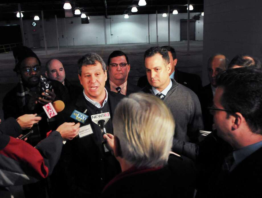 David Lipton, left, and Marc Gare, both of Advanced Grow Labs, a successful applicant to produce  medical marijuana in Connecticut,  speak to the media after Connecticut Governor Dannel P. Malloy and Department of Consumer Protection Commissioner William M. Rubenstein announced that four applicants have been chosen as the first-ever producer of medical marijuana in Connecticut on Tuesday  January 28, 2014. Photo: Peter Hvizdak - New Haven Register  / ©Peter Hvizdak /  New Haven Register