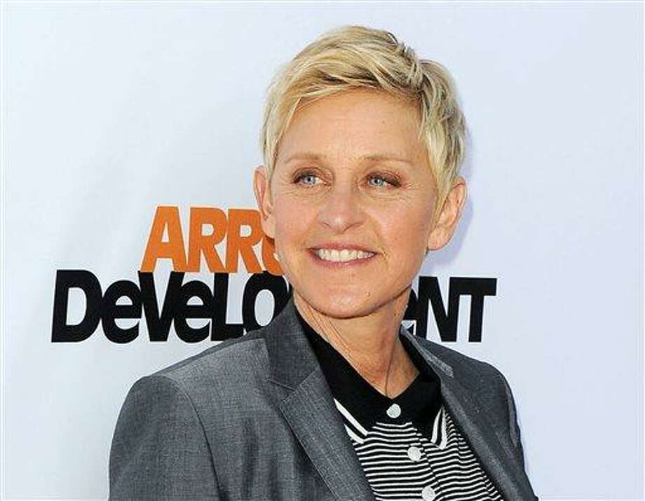 """FILE - In this April 29, 2013 file photo, TV host Ellen DeGeneres arrives at the season 4 premiere of """"Arrested Development"""" in Los Angeles. Producers announced Friday, Aug. 2, that DeGeneres will return to host the Oscars on March 2, 2014. (Photo by Katy Winn/Invision/AP, File) Photo: Katy Winn/Invision/AP / AP2013"""