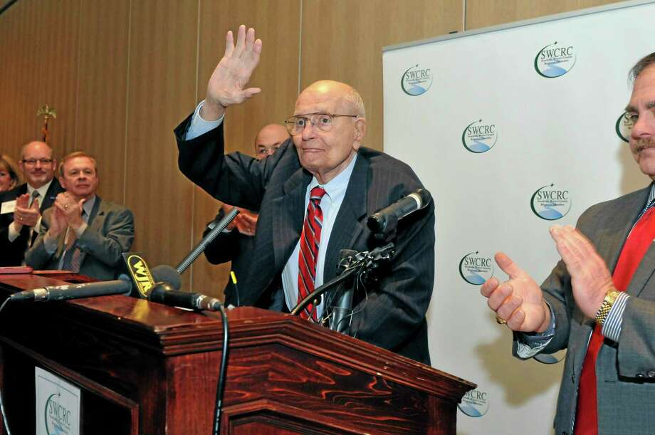 U.S. Rep. John Dingell, center, is welcomed as he arrives at the Southern Wayne County Regional Chamber (SWCRC) Legislative forum held at the Crystal Gardens in Southgate, Mich. on Monday, Feb. 24, 2014. Dingell, the longest-serving member of Congress in American history and a champion of Detroit's auto industry, has announced his retirement. (AP Photo/Detroit News, Max Ortiz)  DETROIT FREE PRESS OUT; HUFFINGTON POST OUT Photo: AP / Detroit News
