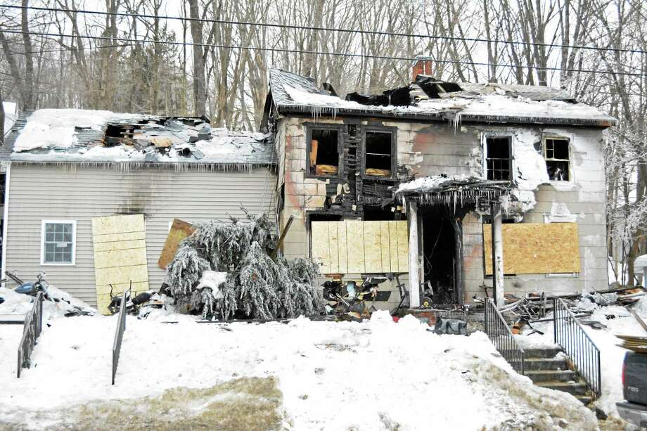 The scene at 115 Prospect St. in Winsted where a fire caused heavy damage to a home early Monday morning. Photo: Ryan Flynn — Register Citizen