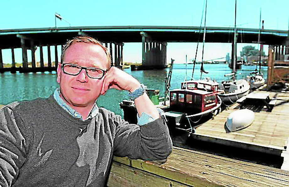 Chris German, founder and former CEO of Connecticut Community Boating, poses on the dock in Bridgeport. German is hoping to lead a resurgence of the Whig Party in Connecticut. (Peter Hvizdak/New Haven Register) Photo: Journal Register Co.