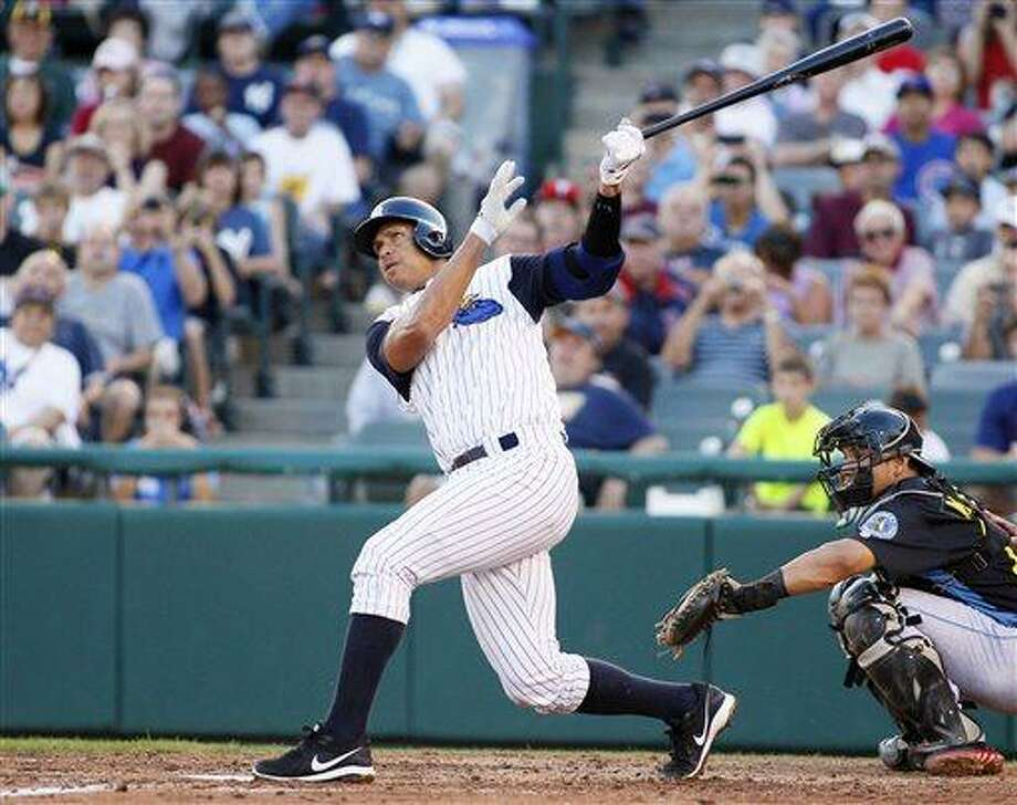 New York Yankees' Alex Rodriguez hits a solo home run in the third inning of a Class AA baseball game with the Trenton Thunder against the Reading Phillies, Friday, Aug. 2, 2013, in Trenton, N.J. (AP Photo/Tom Mihalek) Photo: ASSOCIATED PRESS / TOM MIHALEK2012