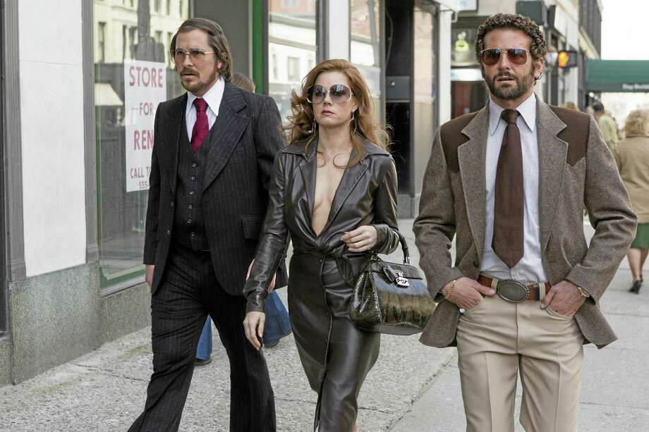 "This photo released by Sony Pictures shows Christian Bale, left, as Irving Rosenfeld, Amy Adams as Sydney Prosser, and Bradley Cooper as Richie Dimaso walking down Lexington Avenue in a scene from Columbia Pictures' film, ""American Hustle."" Photo: Francois Duhamel — Sony-Columbia Pictures — The Associated Press  / Sony Pictures"