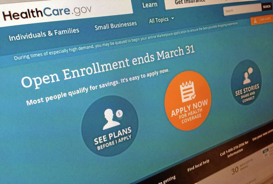 This March 1, 2014, photo shows part of the website for HealthCare.gov as photographed in Washington. Sick of hearing about the health care law? Plenty of people have tuned out after all the political jabber and website woes. Now is the time to tune back in, before itís too late. The big deadline is coming March 31. (AP Photo/Jon Elswick) Photo: AP / AP