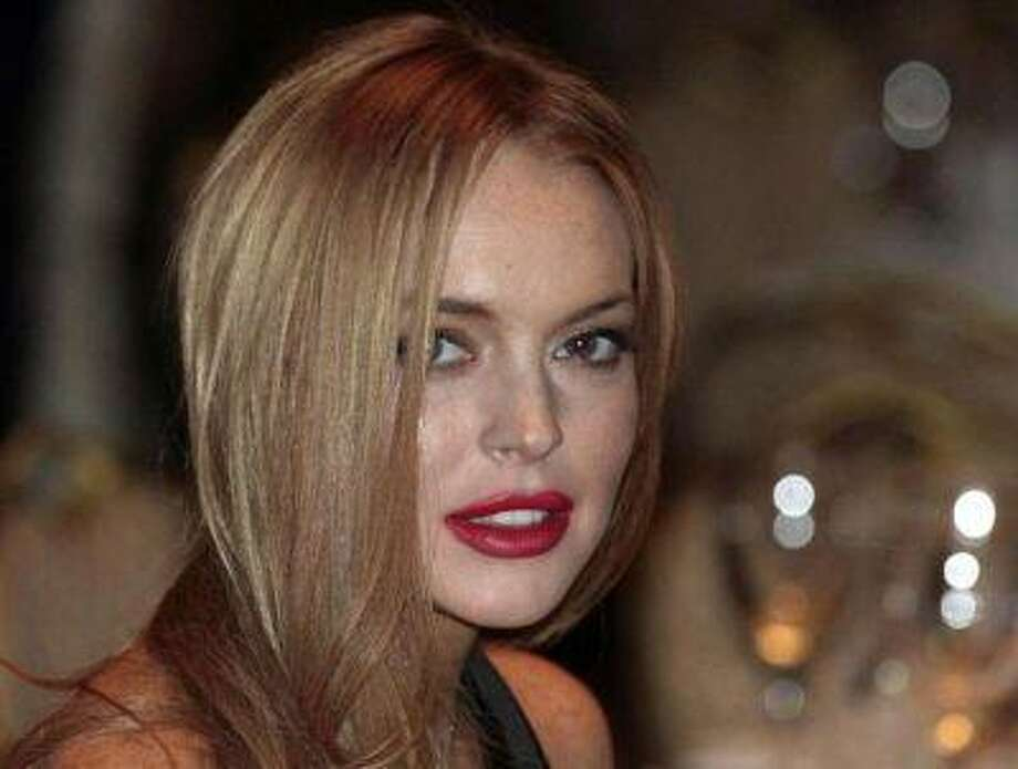 Actress Lindsay Lohan attends the White House Correspondents' Association annual dinner in Washington in this April 28, 2012 file photo. REUTERS/Larry Downing/Files / X00961