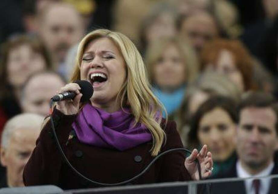 In this Jan. 21, 2013, photo, singer Kelly Clarkson performs at the ceremonial swearing-in for President Barack Obama at the U.S. Capitol in Washington. (AP Photo/Pablo Martinez Monsivais, File) Photo: ASSOCIATED PRESS / A2013