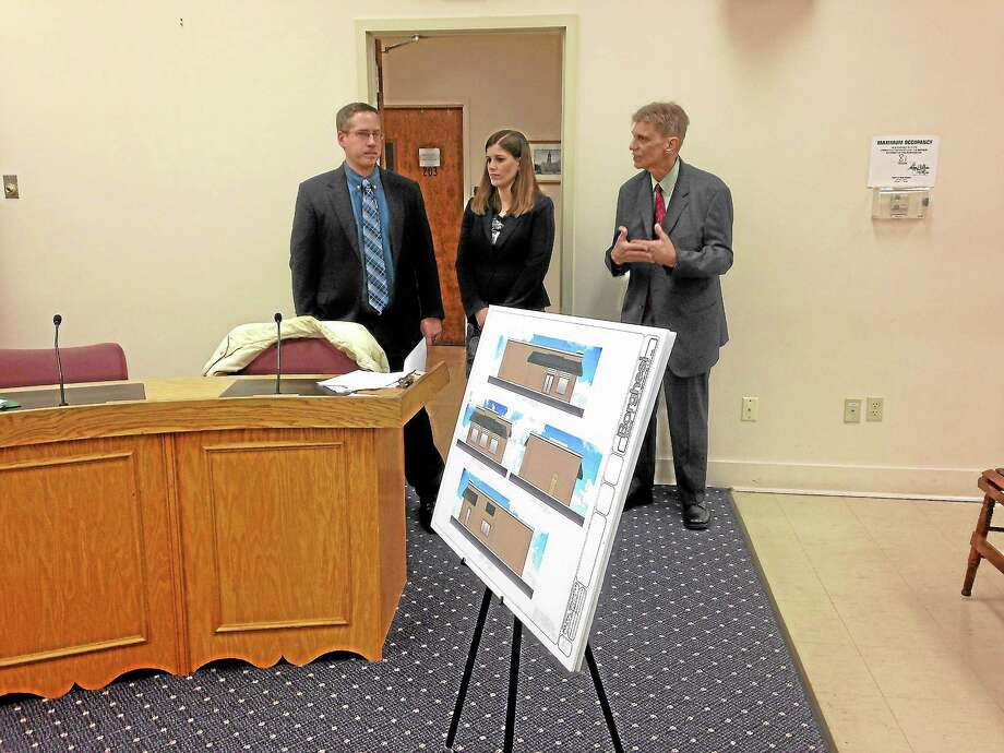 James and Karen Dietz stand with partner Daniel Vaughn to present site plans to the Planning and Zoning Commission. Photo: Mercy Quaye—Register Citizen