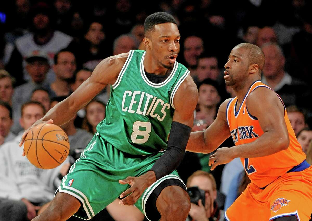 Boston Celtics' Jeff Green (8) drives the ball against New York Knicks' Raymond Felton (2) during the first half of an NBA basketball game on Sunday, Dec. 8, 2013, in New York. The Celtics won 114-73. (AP Photo/Kathy Kmonicek)