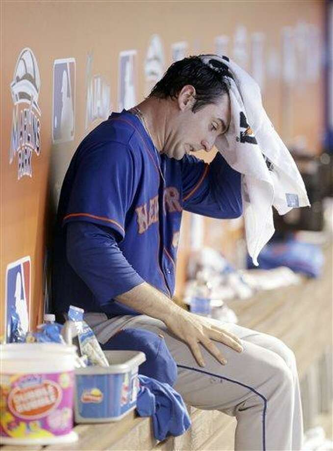 New York Mets pitcher Matt Harvey wipes his head as he sits in the dugout in the sixth inning of a baseball game against the Miami Marlins, Thursday, Aug. 1, 2013 in Miami. The Marlins defeated the Mets 3-0. (AP Photo/Wilfredo Lee) Photo: AP / AP
