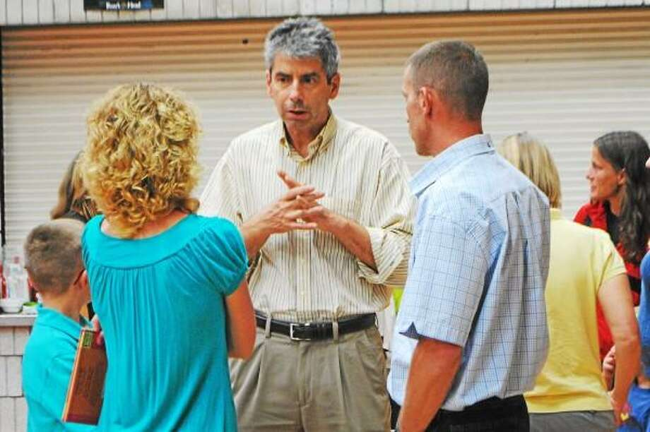 Region 6 School District Superintendent Edward Drapp talks with parents at an ice cream social, Thursday. (Jessica Glenza-Register Citizen)