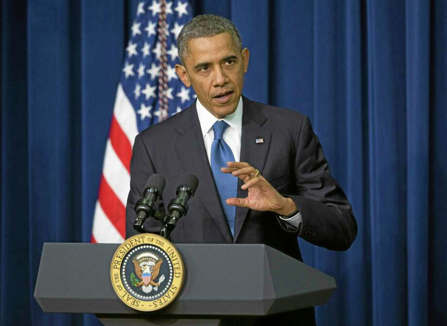 President Barack Obama gestures as speaks about the new health care law to a White House Youth Summit event, Wednesday, Dec. 4, 2013, in the South Court Auditorium in the Eisenhower Executive Office Building on the White House complex in Washington. (AP Photo/ Evan Vucci) Photo: AP / AP