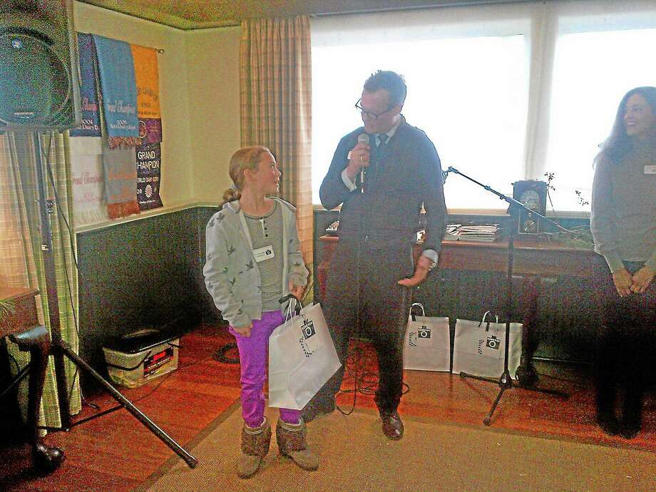 Katherine Benson  being interviewed by Visko Hatfield after receiving her prize as the winner of the ASAP art show's grade 3-5 category.Gayla Cawley - Register Citizen Photo: Journal Register Co.