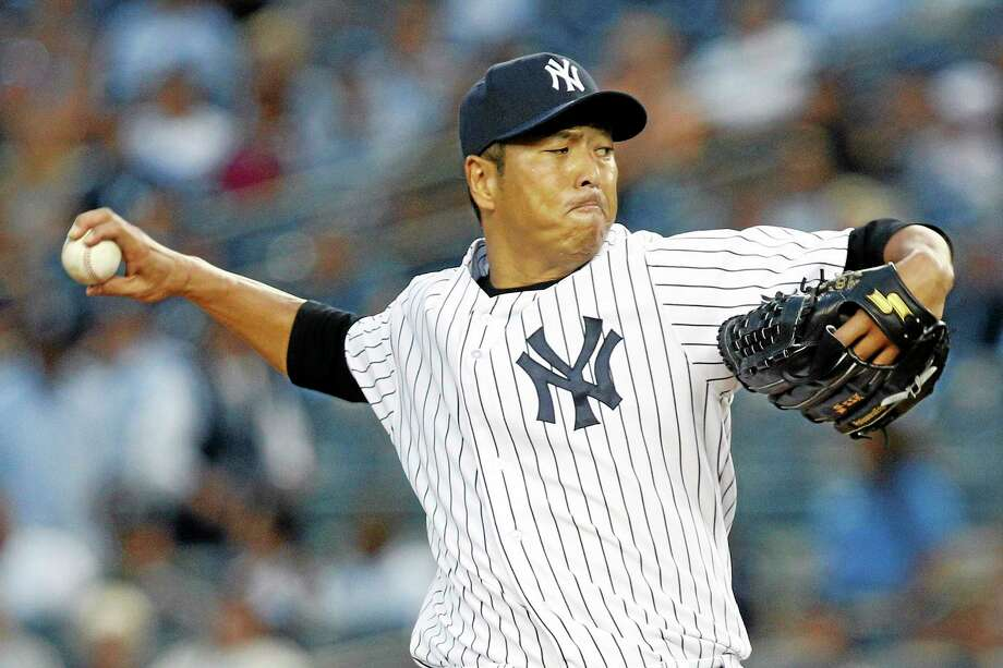 New York Yankees starter Hiroki Kuroda is returning for a third season with the Bombers. Photo: John Minchillo — The Associated Press  / FR170537 AP