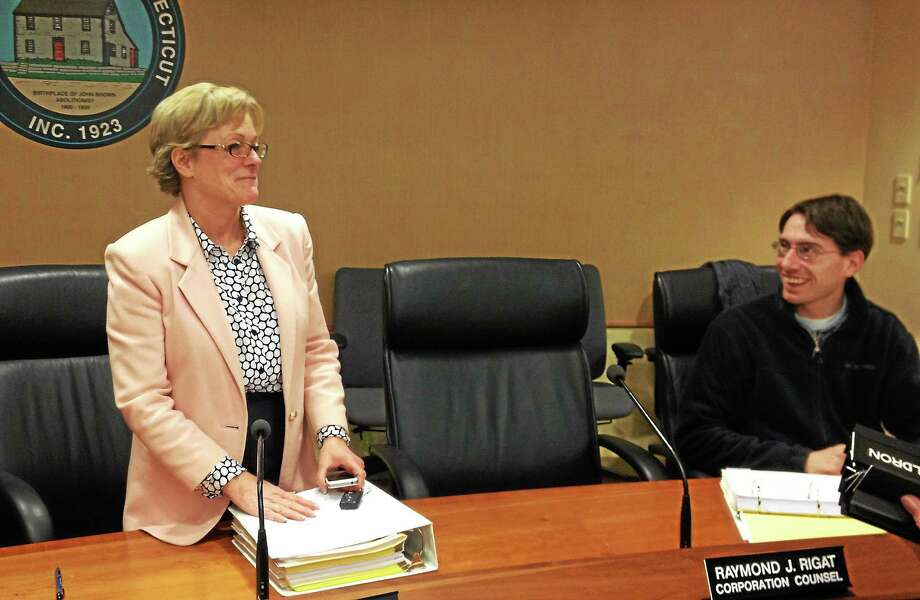 Torrington Mayor Elinor Carbone stands while talking to council member Christopher Anderson at the conclusion of a City Council meeting Monday. Photo: Esteban L. Hernandez — Register Citizen