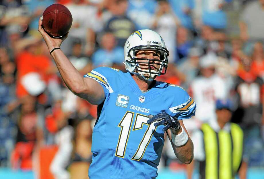 Chargers quarterback Philip Rivers will square off against the Giants' Eli Manning Sunday for the third time since being traded for each other on draft day 2004. Photo: Denis Poroy — The Associated Press  / FR59680 AP