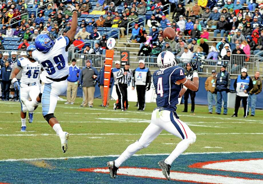 UConn receiver Deshon Foxx (4) gets by Memphis defensive back Reggis Ball (39) for a touchdown reception during the first half of the Huskies' 45-10 win at Rentschler Field in East Hartford in their season finale on Saturday. Photo: Fred Beckham — The Associated Press  / FR153656 AP