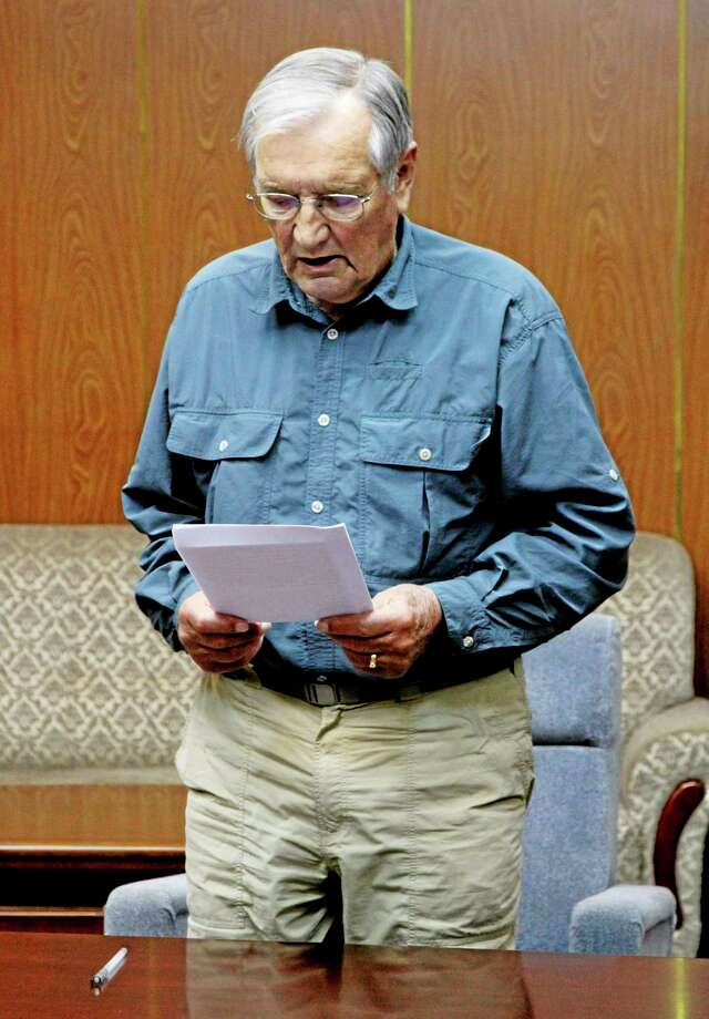 FILE - In this Nov. 9, 2013 file photo released by the Korean Central News Agency (KCNA) and distributed Nov. 30, 2013 by the Korea News Service, U.S. citizen Merrill Newman, 85, reads a document, which North Korean authorities say was an apology that Newman wrote and read in North Korea. North Korea said Saturday Dec. 7, 2013, that it has deported the elderly U.S. tourist and war veteran detained for more than a month for alleged hostile acts against the country.  (AP Photo/KCNA via KNS) Photo: AP / KCNA via KNS