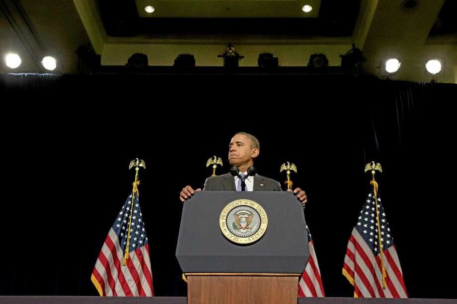 President Barack Obama pauses while speaking at the House Democratic Issues Conference in Cambridge, Md. Friday, Feb. 14, 2014. The president said top priorities for Congress should be increasing the minimum wage and reforming immigration. Obama told a House Democratic retreat Friday that the party needs to stand up for the American dream of getting ahead. (AP Photo/Jacquelyn Martin) Photo: AP / AP