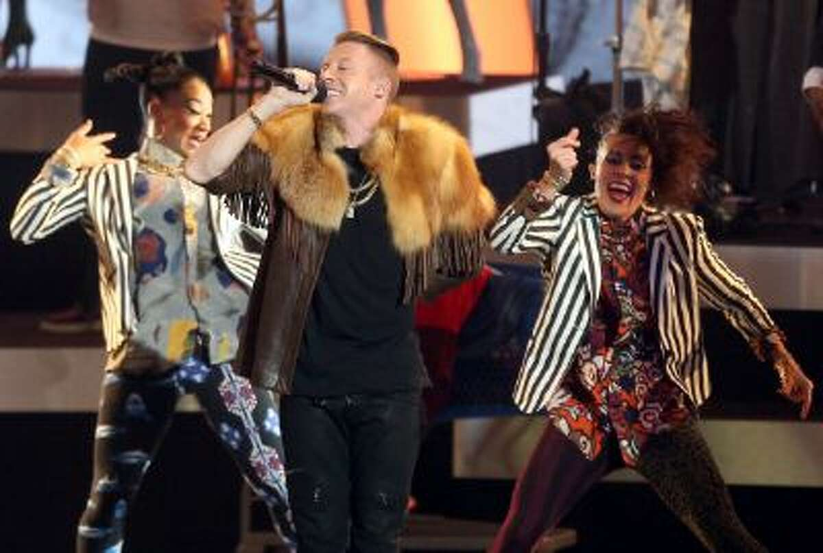 Macklemore performs onstage during a concert to announce the Grammy Award nominations at Nokia Theatre L.A. Live on Dec. 6 in Los Angeles.