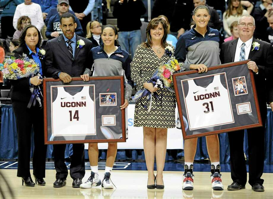 UConn senior Bria Hartley, third from left, stands with her parents, Simone and Dennis Hartley, and senior Stefanie Dolson, second from right, stands with her parents, Krystal and Steve. The two were inducted into the Huskies of Honor on Senior Day at Gampel Pavilion in Storrs before Saturday's 72-35 win over Rutgers. Photo: Jessica Hill — The Associated Press  / FR125654 AP