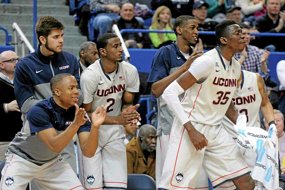 UConn players react during the second half of the Huskies' 51-45 win over No. 11 Cincinnati at the XL Center in Hartford on Saturday afternoon. Photo: Fred Beckham — The Associated Press  / FR153656 AP