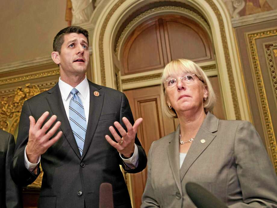 FILE - In this Oct. 17, 2013, file photo, House Budget Committee Chairman Rep. Paul Ryan, left, R-Wis., accompanied by Senate Budget Committee Chair Sen. Patty Murray, D-Wash., speaks on Capitol Hill in Washington where they outlined their approach to tackling the nation's debt problems. Since the end of World War II, more than a dozen high-profile bipartisan panels have been convened to tackle the nation's thorniest fiscal problems. But seldom have their recommendations spurred congressional action. Their ambitious, high-octane reports and recommendations are mostly still gathering dust on government shelves. Right now, congressional negotiators are grappling with a way to head off another looming government shutdown and debt ceiling crisis that could strike early next year. The 29-member bipartisan panel faces a Dec. 13 deadline and daunting odds.(AP Photo/ Scott Applewhite, File) Photo: AP / AP