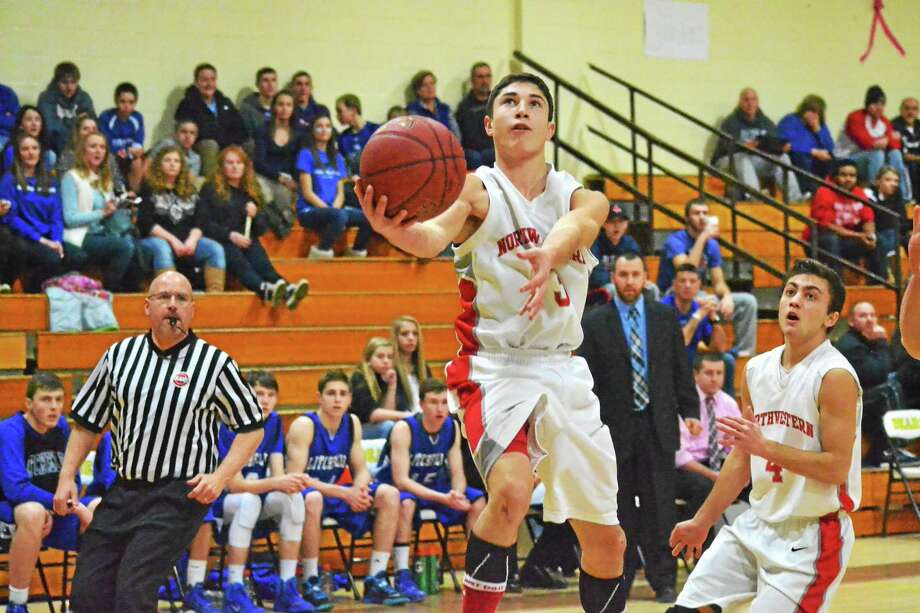 Northwestern's Ricky Persechino lays in two of his 15 points in the Highlanders win over Litchfield. Photo: Pete Paguaga — Register Citizen