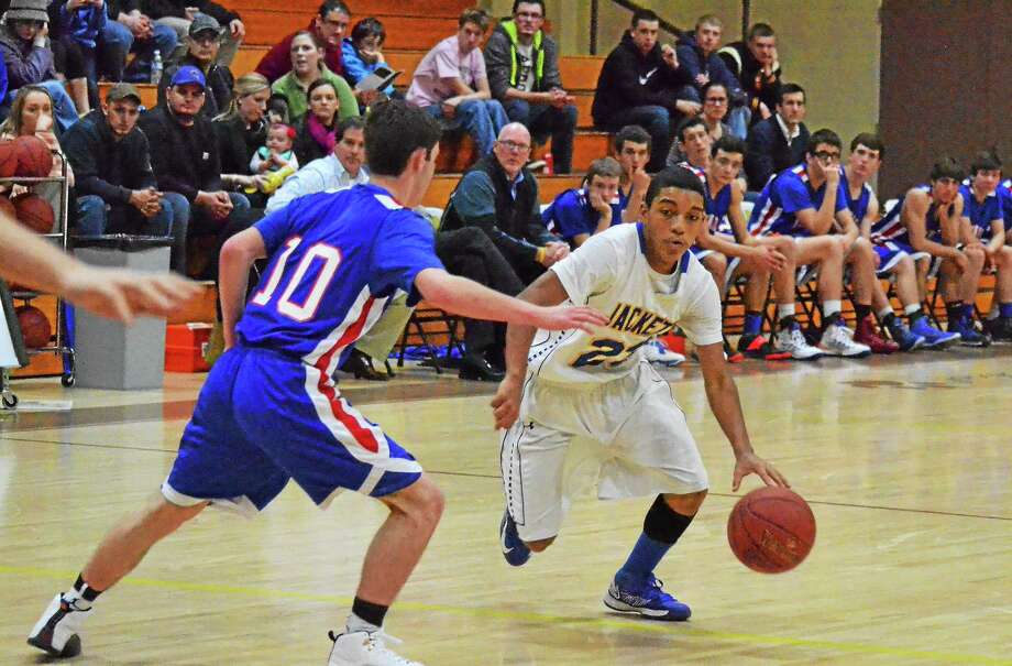 Gilbert's Anthony Gonzalez came up with the steal to help lift the Yellowjackets past the Nonnewaug Chiefs 52-50. Photo: Pete Paguaga — Register Citizen