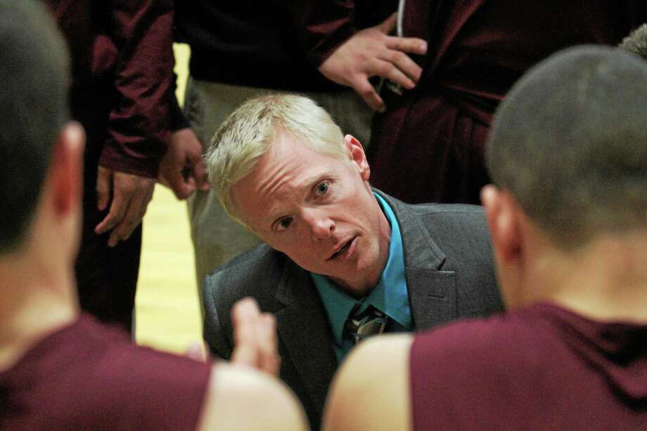 Torrington head coach Eric Gamari talks to his team during the Red Raiders 77-68 win over Kennedy. Photo: Marianne Killackey — Special To The Register Citizen  / 2013