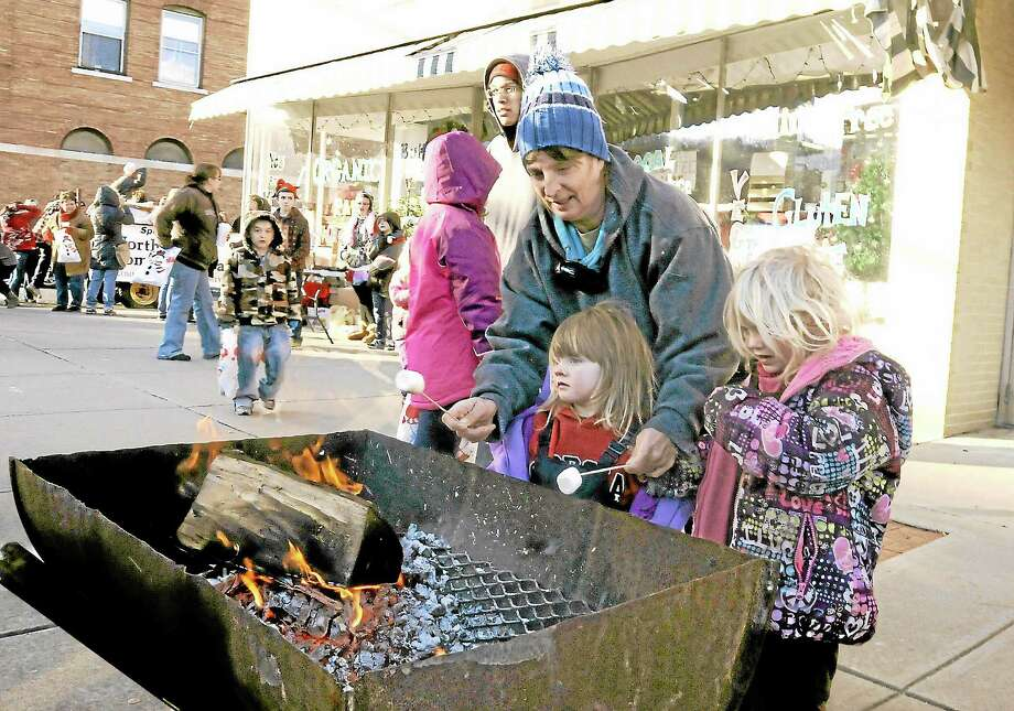 Winsted residents Jean Shafer and her grandchildren Bailey, 3, and Tannyr McLellan, 5, roastoast marshmallows  during Winsted's Christmas on Main Street event Saturday.Laurie Gaboardi - Register Citizen Photo: Journal Register Co.