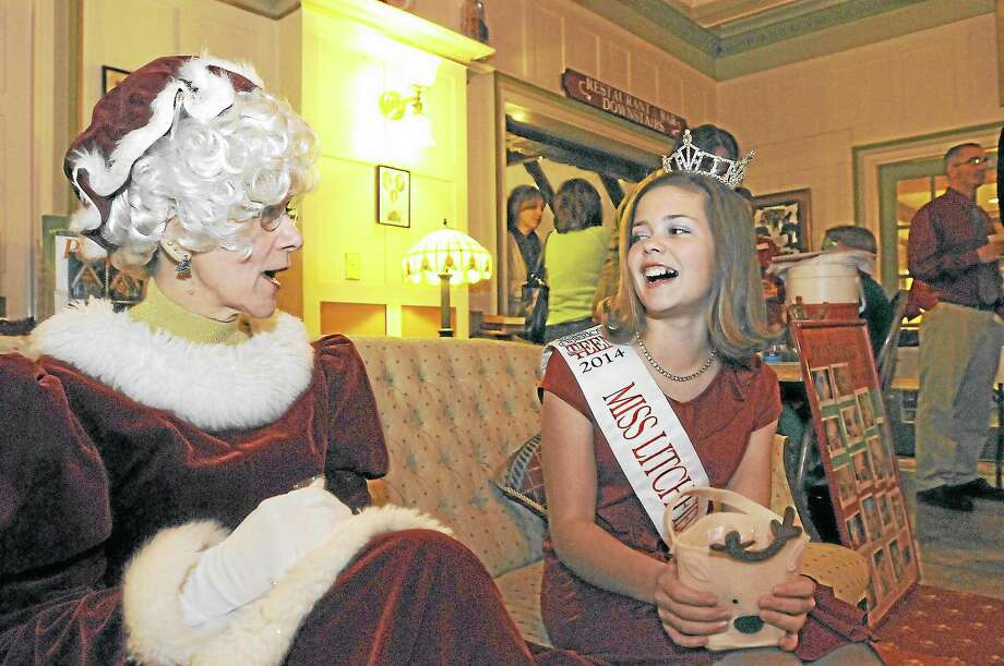 Mrs. Claus chats with Miss Litchfield County's Outstanding Teen, Tara Shaye Lynch, 13, at the toy shower fundraiser for Christmas Village, held Friday at Yankee Pedlar Inn in Torrington.Laurie Gaboardi - Register Citizen Photo: Journal Register Co.