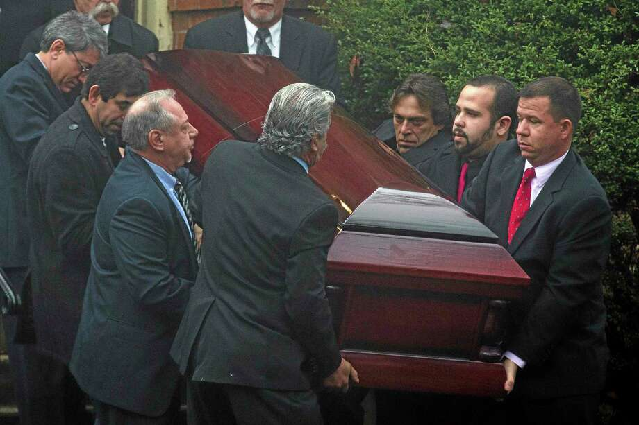 The casket of James Ferrari is carried out the Church of the Divine Love following funeral services, Thursday, Dec. 5, 2013, in Montrose, N.Y. Ferrari, 59, was killed along with three others when a speeding Metro-North Railroad train on the Hudson Line derailed in New York. (AP Photo/John Minchillo) Photo: AP / FR170537 AP