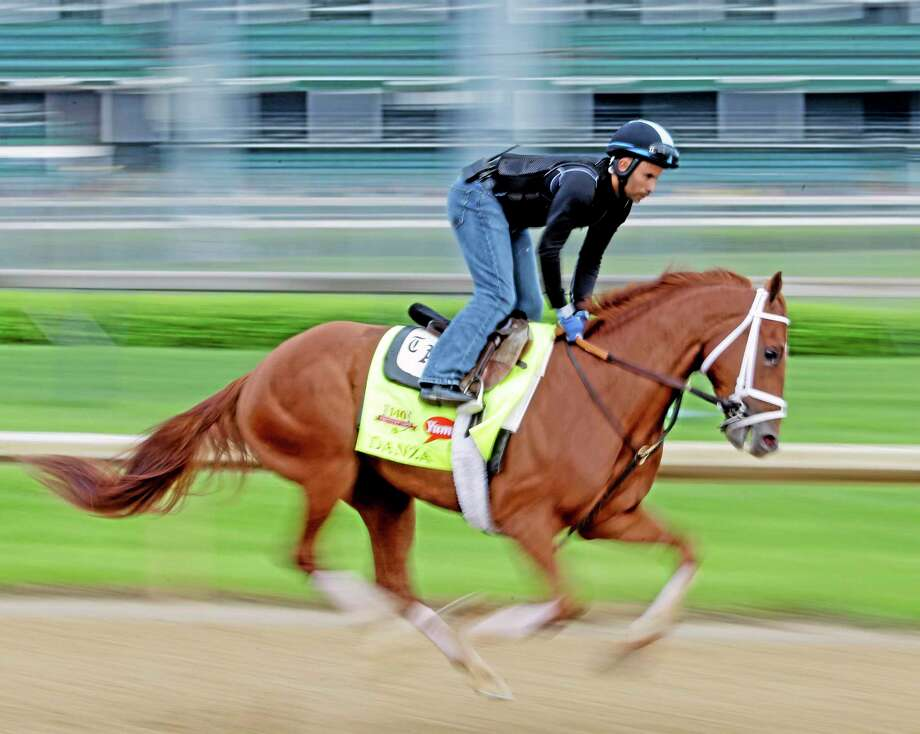Exercise rider Ezequiel Perez takes Kentucky Derby hopeful Danza, trained by Todd Pletcher, for a morning workout at Churchill Downs on Wednesday in Louisville, Ky. Photo: Morry Gash — The Associated Press  / AP