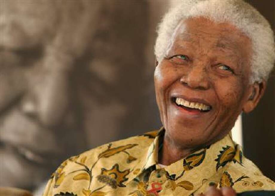 """FILE - In this Dec. 7, 2005, file photo, former South African President Nelson Mandela, 87, is in a jovial mood at the Mandela Foundation in Johannesburg, where he met with the winner and runner-up of the local """"Idols"""" competition. South Africa's president says, Thursday, Dec. 5, 2013, that Mandela has died. He was 95. (AP Photo/Denis Farrell, File) Photo: ASSOCIATED PRESS / AP2005"""