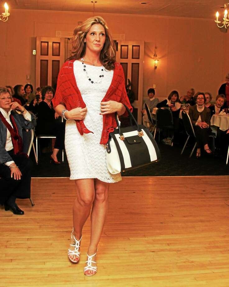 """Submitted photo - Ginger Balch A participant in last year's 'Go Red for Women"""" fashion show hits the floor. The event reprises this year as a fundraiser for Charlotte Hungerford Hospital and a promotion for women's heart disease awareness. Photo: Journal Register Co."""