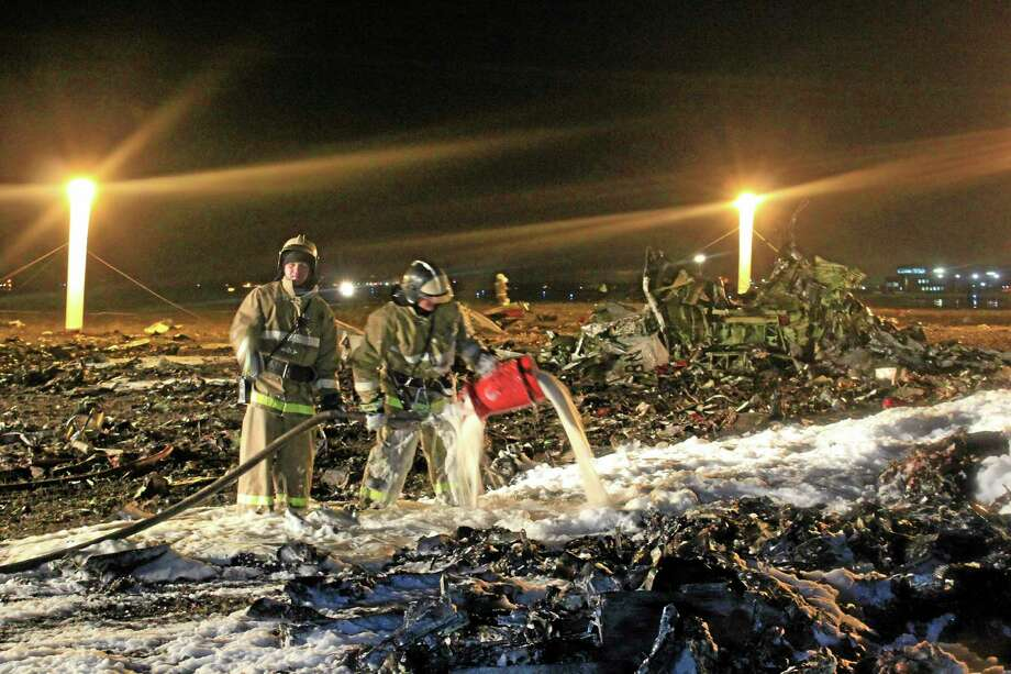 FILE - In this Nov. 17, 2013, file photo provided by Russian Emergency Situations Ministry, firefighters and rescuers work at the crash site of a Russian passenger airliner near Kazan, the capital of the Tatarstan republic, about 720 kilometers (450 miles) east of Moscow. On Friday, Dec. 6, 2013, an investigator said there were reasons to believe the pilot who sent the Boeing 737 into a near-vertical dive, killing all 50 on board, had received his license illegally in a small training center that is no longer functioning. (AP Photo/Russian Emergency Situations Ministry, file) Photo: AP / Russian Emergency Situations Ministry