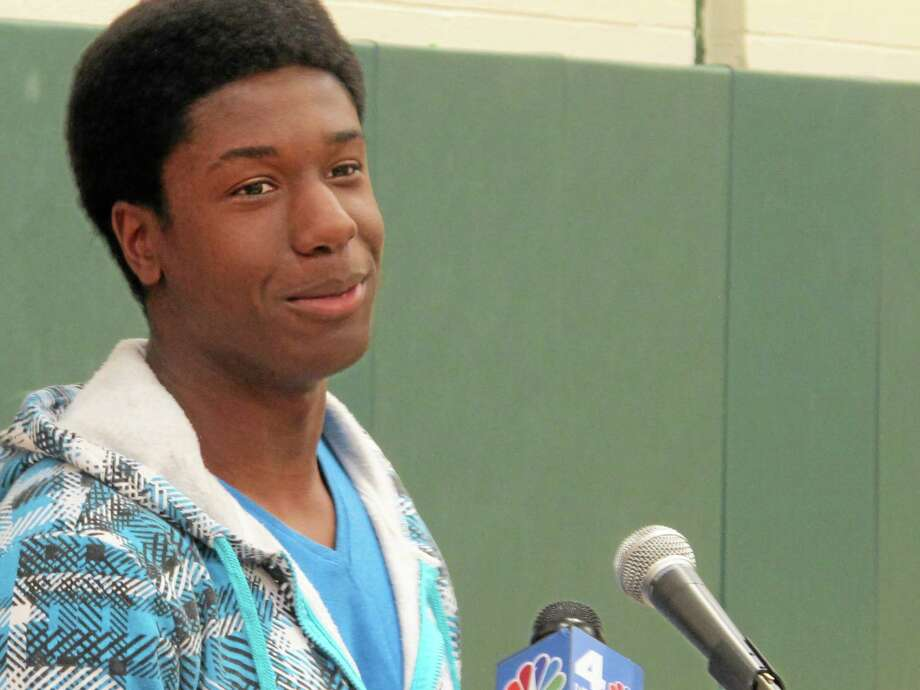 Kwasi Enin speaks at a news conference at William Floyd High School in Mastic Beach, N.Y., on Wednesday, April 30, 2014. Enin, who was accepted into all eight Ivy League colleges, announced he will attend Yale University in the fall. Enin says he wants to study medicine. His parents are both nurses and immigrated to the United States from Ghana in the 1980s. (AP Photo/Frank Eltman) Photo: AP / AP