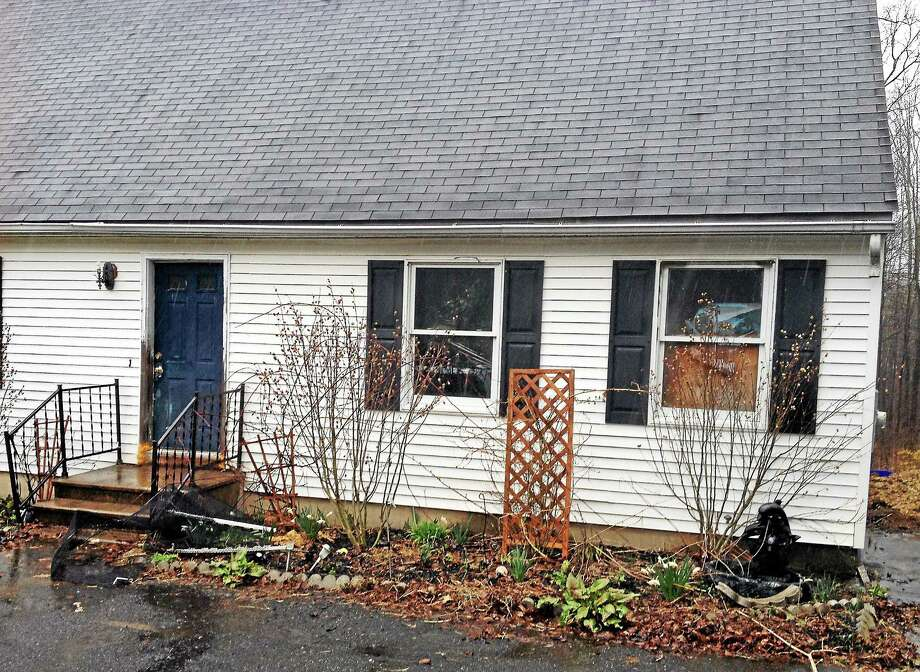 """A home at 285 Hayden Hill Road where more than 25 animals were seized by authorities Monday after police found """"deplorable conditions"""" for the animals. Photo: Isaac Avilucea — Register Citizen"""
