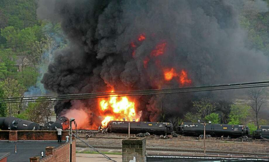 In this image made available by the City of Lynchburg, shows several CSX tanker cars carrying crude oil in flames after derailing in downtown Lynchburg, Va., Wednesday, April 30, 2014. (AP Photo/City of Lynchburg, LuAnn Hunt) Photo: AP / City of Lynchburg