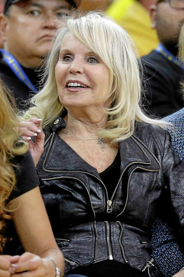 Shelley Sterling, wife of Los Angeles Clippers owner Donald Sterling, watches from a court side seat during the second half in Game 4 of an opening-round NBA basketball playoff series between the Clippers and Golden State Warriors on Sunday, April 27, 2014, in Oakland, Calif. Golden State won 118-97. (AP Photo/Marcio Jose Sanchez) Photo: AP / AP