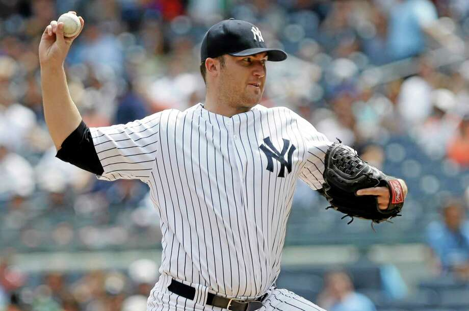 Former New York Yankees starter Phil Hughes has agreed to a $24 million, three-year deal with the Minnesota Twins. Photo: Frank Franklin II — The Associated Press  / AP