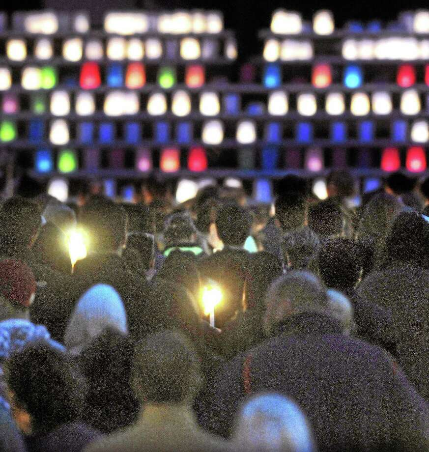 A candlelight vigil for stabbing victim Maren Sanchez is held at the Jonathan Law High School football field Monday in Milford. Photo: Mara Lavitt — New Haven Register     / Mara Lavitt
