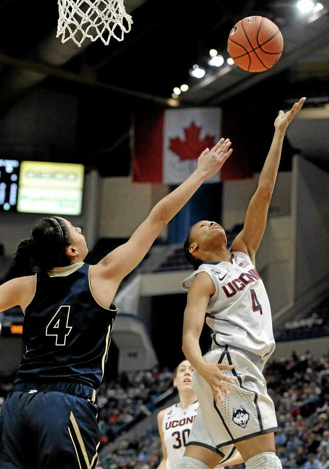 UConn's Moriah Jefferson, right, shoots over UC Davis' Idit Oryon, left, during the first half of Thursday's game in Hartford. Photo: Jessica Hill — The Associated Press   / FR125654 AP