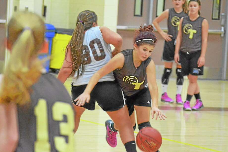 Thomaston senior Morgan Graham dribbles past a defender during practice. The Golden Bears won the Berkshire League last season and made a trip to the Class S title game. Photo: Pete Paguaga — Register Citizen